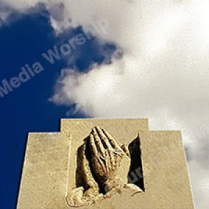Hands in prayer Christian Worship Background. High quality worship images for use to spread the Gospel and enhance the worship experience.