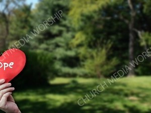 Child holding paper heart - Hope Christian Worship Background. High quality worship images for use to spread the Gospel and enhance the worship experience.