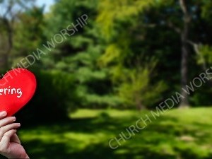 Child holding paper heart - Offering Christian Worship Background. High quality worship images for use to spread the Gospel and enhance the worship experience.