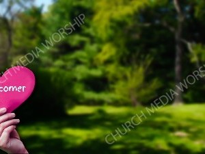 Child holding paper heart - Overcomer Christian Worship Background. High quality worship images for use to spread the Gospel and enhance the worship experience.