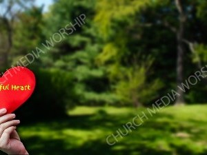 Child holding paper heart - Thankful Heart Christian Worship Background. High quality worship images for use to spread the Gospel and enhance the worship experience.