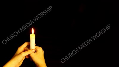 Handle holding single candle Christian Worship Background. High quality worship images for use to spread the Gospel and enhance the worship experience.