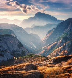 Mountain canyon lighted by bright sunbeams at sunset in autumn