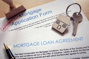Mortgage application loan agreement and house key