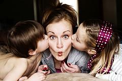 small_mommy_sandwich_kids_kissing_mom.jpg