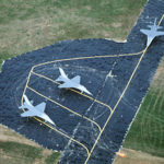 Military deception: fake aircraft on a fake runwayPhoto by USAF, Public domain