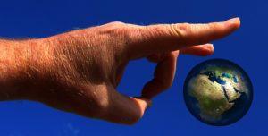 hand_flicks_globe_world_earth