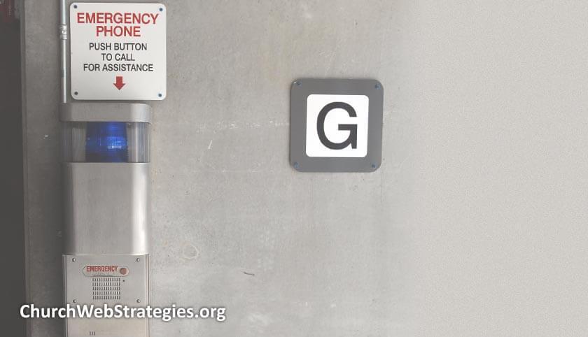emergency phone on wall in parking garage