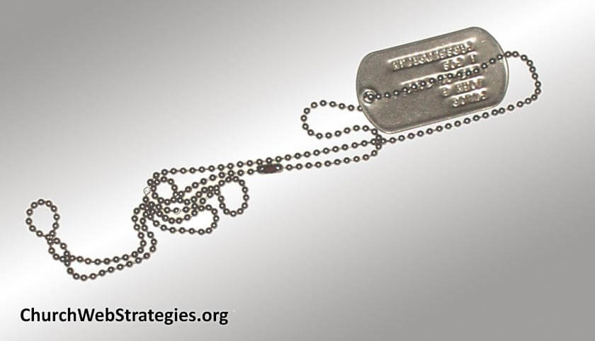 military dog tags on table