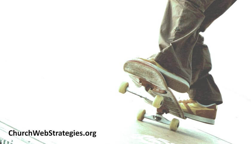 close-up of person standing on a skateboard