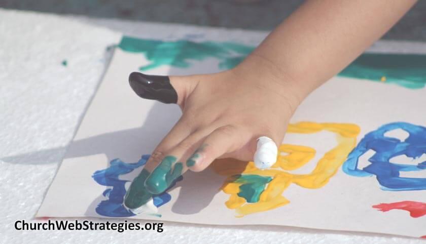 child's hand finger painting