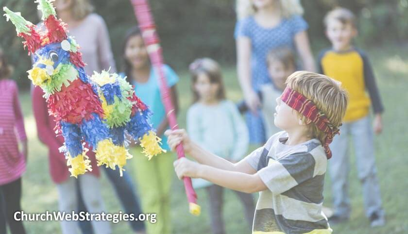 blindfolded child hitting pinata