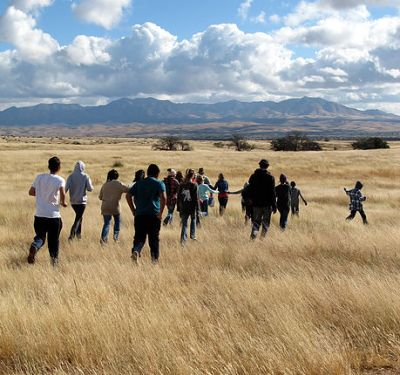 Students explore the grasslands of the Cienega watershed.