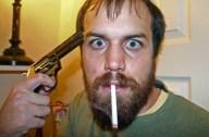 Picture of Man With Gun Smoking