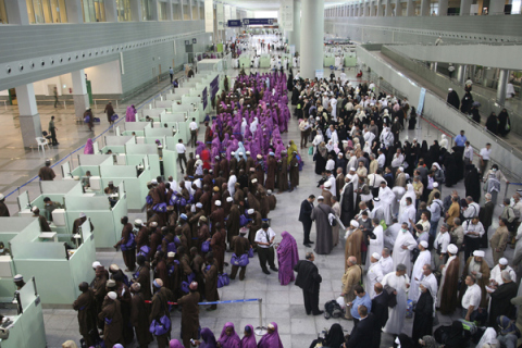 Pilgrims queue upon their arrival at Jeddah airport