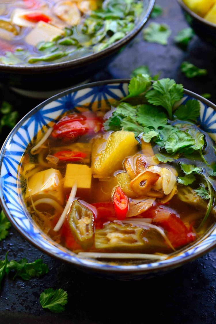 This Vietnamese sour soup recipe is ready in just 15 minutes and so full of complex flavours and textures that it just might be the most delicious bowl of soup you've ever tasted. This is a vegetarian version of canh chua with tamarind, pineapple, okra and silken tofu. The combination seems weird but I'm sure it will quickly become your new favourite soup!