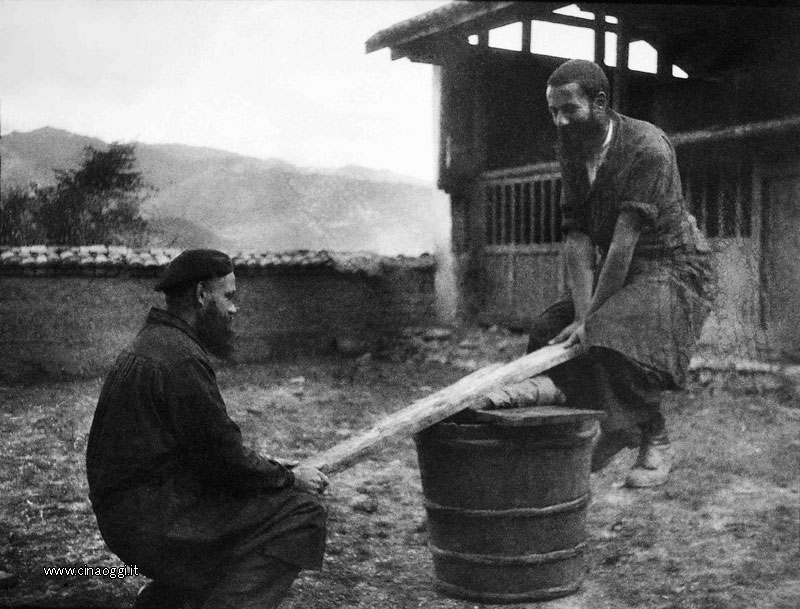 Friar Louis Duc and lay missionary Robert Chappelet playing