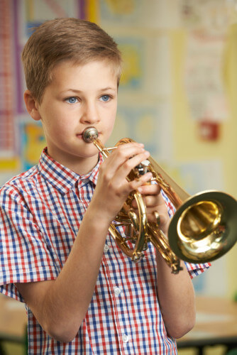 Boy taking trumpet lesson in Katy