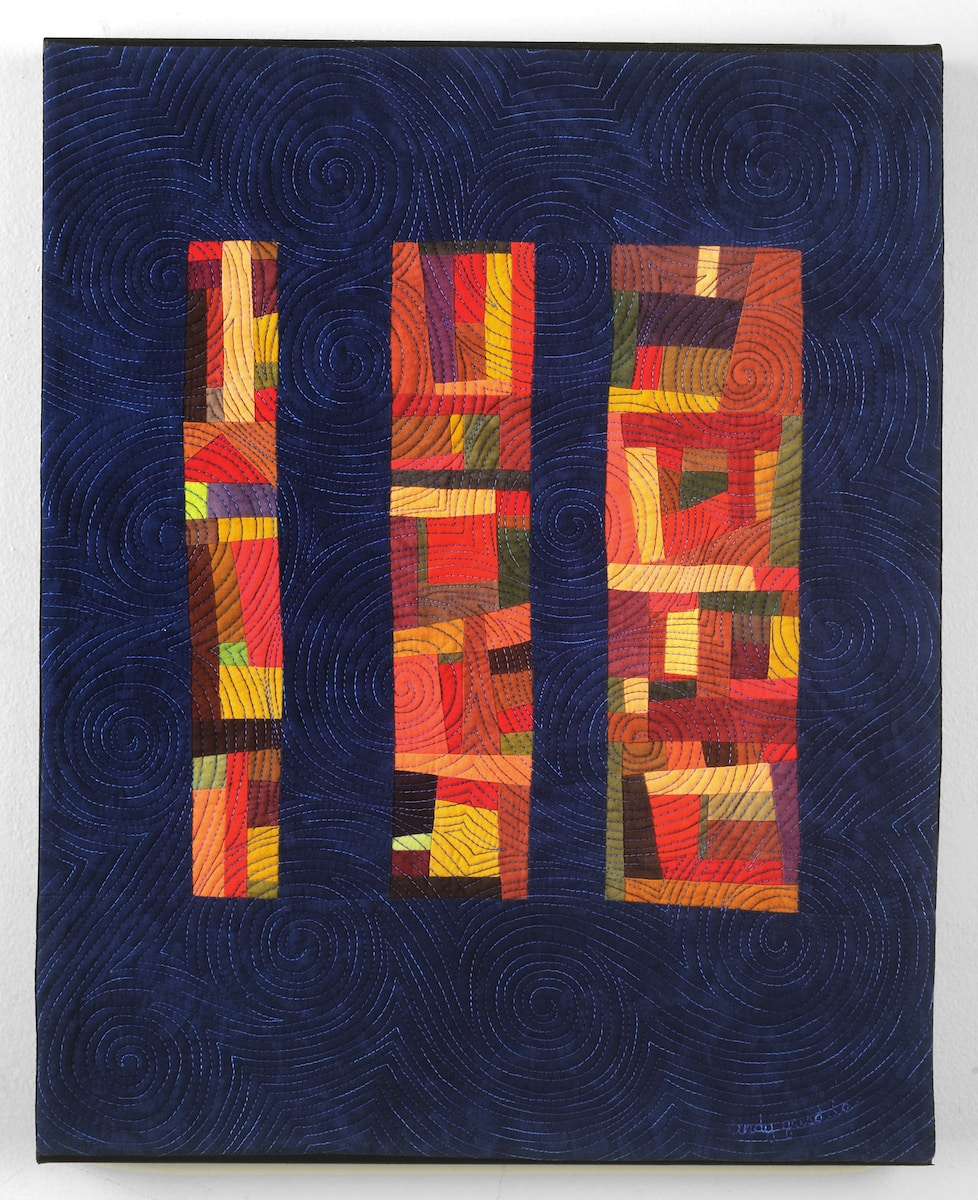 Second Chances Art Quilt with red improv blocks and blue background - Cindy Grisdela