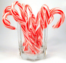 """Candy Canes: The candy canes are used to remind us of the Shepherd's staff, used to guide the sheep. Of course, Jesus is considered to be a shepherd and """"people"""" the sheep that he guides. The white stripe in the candy cane symbolizes the purity of his perfect life and the red for the blood of Jesus. The stripes on the candy cane represent the """"stripes"""" that Jesus suffered for us during the crucifixion."""