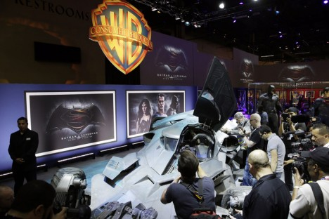"""Members of the media and fans gather as Warner Bros. Consumer Products exclusively unveils the Batmobile and select costumes from the highly anticipated film, """"Batman v Superman: Dawn of Justice"""" at Licensing Expo 2015 on Tuesday, June 9, 2015 in Las Vegas. (Photo by Isaac Brekken/Invision for Warner Bros./AP Images)"""