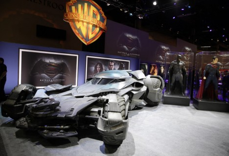 """Warner Bros. Consumer Products exclusively unveils the Batmobile and select costumes from the highly anticipated film, """"Batman v Superman: Dawn of Justice"""" at Licensing Expo 2015 on Tuesday, June 9, 2015 in Las Vegas. (Photo by Isaac Brekken/Invision for Warner Bros./AP Images)"""