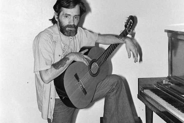 manson with a guitar
