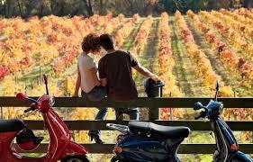 turisti del vino in vespa