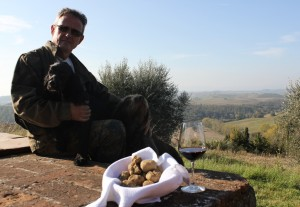 White-truffle-hunter-with-his-dog