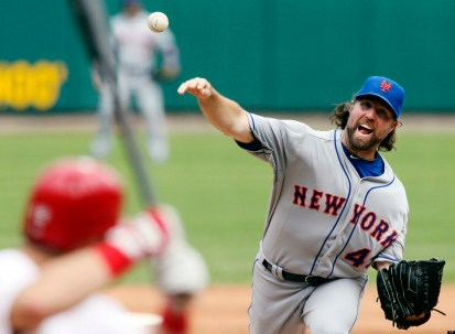 New York Mets starting pitcher R.A. Dickey delivers against the St. Louis Cardinals during a baseball game, Wednesday, Sept. 5, 2012, in St. Louis. The Mets won 6-2. (AP Photo/St. Louis Post-Dispatch, Chris Lee) EDWARDSVILLE INTELLIGENCER OUT; THE ALTON TELEGRAPH OUT