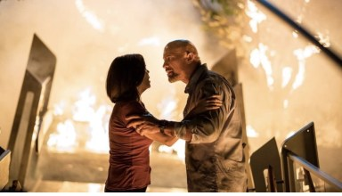 Neve Campbell and Dwayne Johnson star in Universal Pictures' SKYSCRAPER