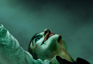 Poster image of Joaquin Phoenix in Warner Bros. Pictures' JOKER