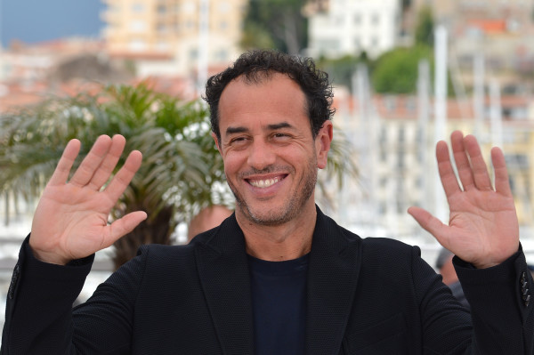 """Italian director Matteo Garrone poses during the photocall of """"Reality"""" presented in competition at the 65th Cannes film festival on May 18, 2012 in Cannes. AFP PHOTO / ALBERTO PIZZOLI (Photo credit should read ALBERTO PIZZOLI/AFP/GettyImages)"""