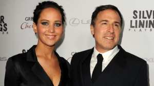 Jennifer Lawrence e David O. Russell   © Kevin Winter/Getty Images