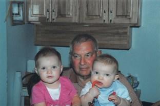 Dwayne Hanson of Nevada, Iowa with two of his grandchildren.