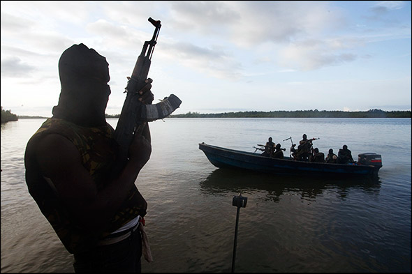 Members of the militant group MEND patrol the water of the Niger Delta. The river and streams serve as the primary fighting ground for the group. Photo by Ed Kashi.