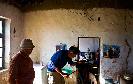 "Most of Circle of Blue's reporting occurred in East Umchjin County, near the border with Mongolia, a place renowned for what Chinese scientists call ""typical grasslands."" Here Eric Daigh, senior producer, prepares for an interview in a herder's home."