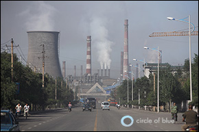 The smoke stacks of the Baosteel Complex dominate the skyline of Baotou, Inner Mongolia. The anchor of the city's economy, the iron and steel giant has historically dumped much of its wastewater into the Yellow River. Click image to enlarge.