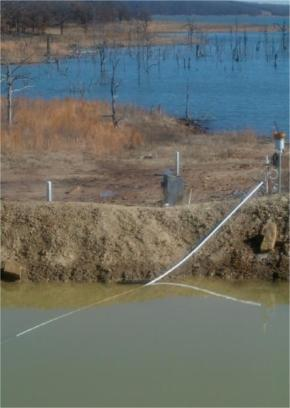 Produced water brine pit in Oklahoma oil and gas field.