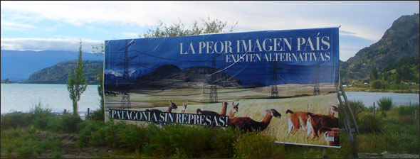 "In Puerto Rio Tranquilo, a town along the General Carrera Lake, a billboard by the Patagonia Sin Represas organization features an image of Patagonian landscape with photoshopped-in electric tower reading ""The worst image for the country: alternatives exist. Patagonia Without Dams!"