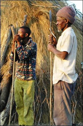 Nyare Bapalo and his grandnephew Moagi sharpening spears before a hunt