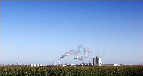ROCHELLE, ILLINOIS, AUGUST 2010: The Illinois River Energy biofuels plant in Rochelle releases plumes of steam at sunrise. The ethanol plant processes over 40 million bushels of corn into 115 million gallons of fuel grade ethanol annually. The plant is one of hundreds around the country transforming corn into ethanol. It takes nearly 1,000 gallons of water to produce a gallon of ethanol from irrigated corn: four gallons from unirrigated corn.