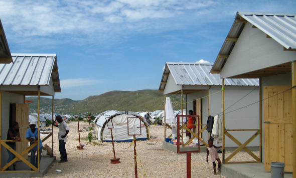 Haiti cholera earthquake health disease epidemic outbreak tent camp water sanitation latrine shelter