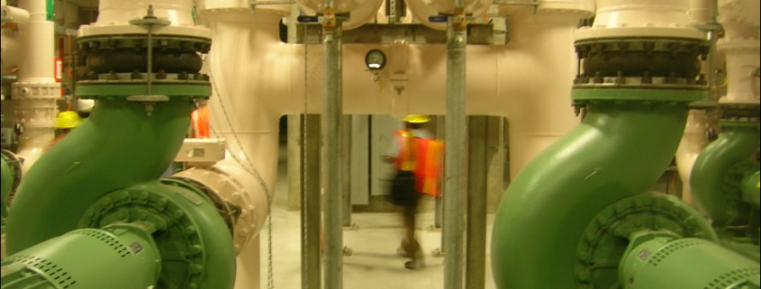 Workers walk through the mechanical room underneath the membrane filters.