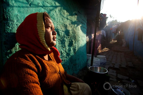 Inside the community of brick-walled huts the smell of spices and breakfast hung in the air.