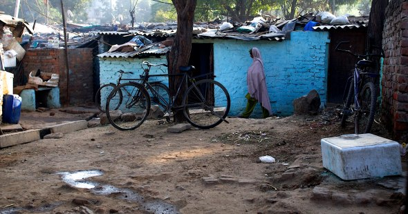 Delhi's slum hut neighborhoods spring up on expanses of rubble, or in empty lots, or in abandoned industrial areas, or along some of the city's busiest streets.