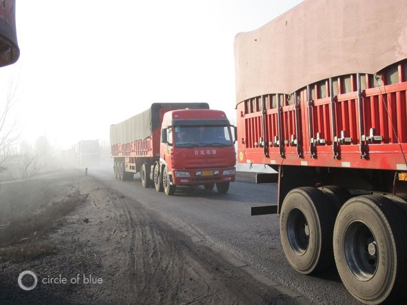 China coal reserves trucks desert climate change mining industry pollution