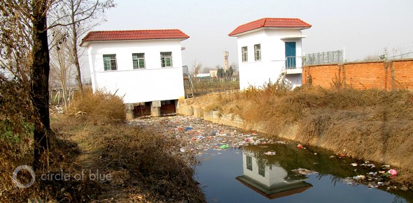 water pollution contamination china xian shanxi province pesticide plastic bottle irrigation canal agriculture