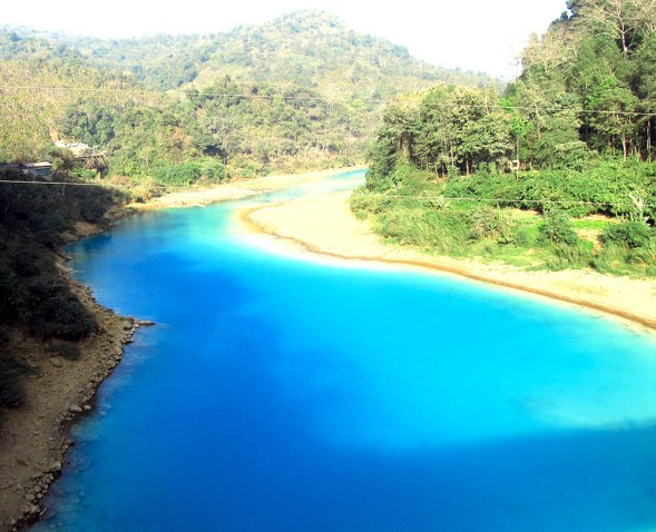 The Lukha River, near the border with Bangladesh, runs Gatorade blue due to sulphate pollution from Meghalaya's coal mines.