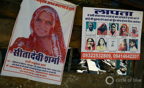 Posters of missing Hindu pilgrims are grim ornaments on the walls of buildings that still stand in Sonprayag, downriver on the Mandkini River from the Kedarnath temple. The Uttarakhand government counts almost 600 bodies recovered after the flood and more than 5,000 missing. Residents of the region and a researcher at the Wadia Institute of Himalayan Geology assert that 30,000 people perished in the June flood. Photo: Dhruv Malhotra